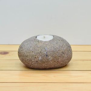 River Stone With Candle