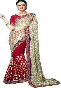 Georgette And Brasso Cream Coloured Party Wear Stone Work Saree With Blouse