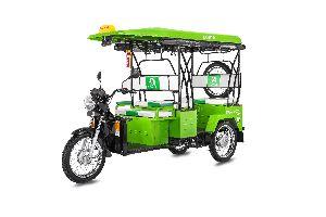 Green Red comfort electric rickshaw