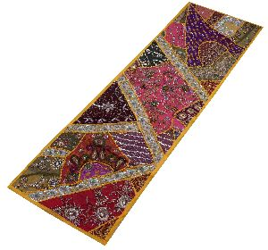 Yellow table top runner wall hanging