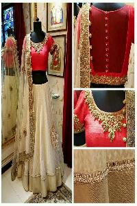 Off White & Red Net & Raw Silk Lehenga Choli