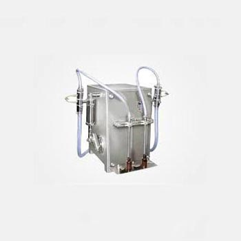 Semi Automatic Two Head Volumetric Liquid Filling Machine