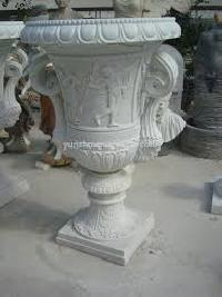 carved stone flower pots