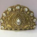 golden metal clutch bag
