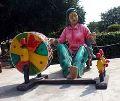 Punjabi Lady Spinning Yarn Charkha Statue