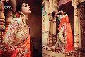 Artistic Orange Crushed Silk On Net Saree